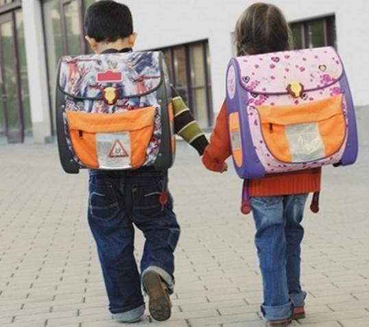 Тяжелый рюкзак – причина плохого почерка школьников